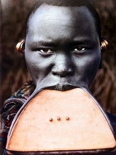 Suri tribeswoman with wooden lip plate, Omo Delta, Ethiopia - © Steve Bloom.