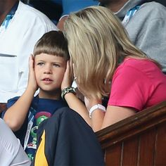HRH The Countess of Wessex with her son James, Viscount Severn watching the Rugby 7's at the Commonwealth Games, Glasgow, Scotland. It seems it all got a bit too loud for young James.