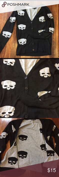 Skull button sweater Skull button up sweater. Worn twice. Comfortable fabric and fit. Buttons only reach half way up. In great condition!! POL Sweaters Cardigans