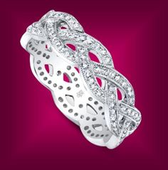 Intertwining love and lives. This amazing diamond band is from the Beverley K collection.