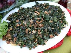 PHOTO: Michael Symons southern greens recipe is shown here. Southern Greens, Southern Dishes, Southern Recipes, Southern Food, Southern Style, Veggie Side Dishes, Vegetable Dishes, Collard Greens With Bacon, Spinach Recipes