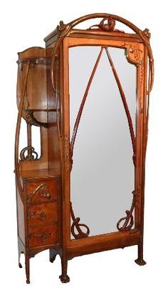 Léon Bénouville (1860-1903) - Art nouveau Armoire Cabinet. Carved Mahogany, Mirrored Glass & Glass with Bronze Hardware & Mounts. France. Circa 1900.