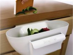 The Scrap Trap - a handy scrap bowl that fits under the counter, over the drawer or door. It saves countertop space and makes brushing the scraps off the counter a breeze.- $8.88