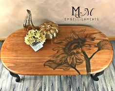 Hand stained sunflower on top of coffee table.