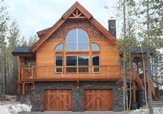 I like the rock work on the garages and how they form the bottom floor of the home.