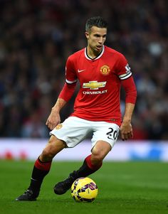 Robin van Persie of Manchester United in action during the Barclays Premier League match between Manchester United and Chelsea at Old Trafford on October 26, 2014 in Manchester, England.