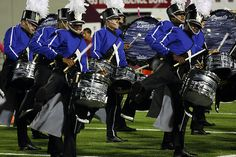 College aged students have the opportunity to compete during the summer in the Drum Core International. Students travel the country and perform to compete against other groups. In this image, the Blue Devils drumline performs in a competition. SOURCE: https://www.flickr.com/photos/wfiupublicradio/2744124703/