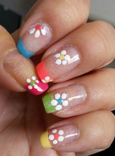 Summer colors french manicure with garden flowers.