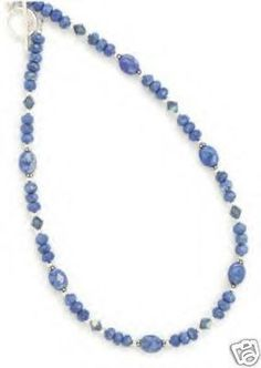 This beautiful necklace features genuine lapis and Austrian crystals!