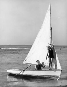 Couple on small sail boat, 1950's