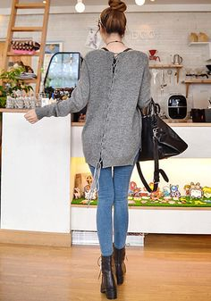 What a cute lace up sweater. Comfy and stylish, the perfect combination!