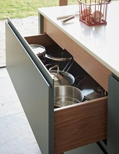 It is all in the detail with the cabinetry from John Lewis of Hungerford.  Even with our most contemporary kitchen style we still use traditional methods to make our solid oak drawer boxes.  In this client's kitchen this drawer pack allows for two extra deep drawers, one for pots and pans at the bottom, leaving room for the top one to store bowls and plates as well as a hidden cutlery tray.