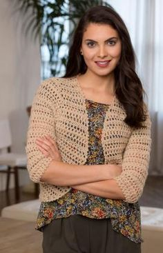 Crochet a bolero that matches everything! With a lacy pattern and three-quarter-length sleeves, this sweater goes from daytime to evening wi...