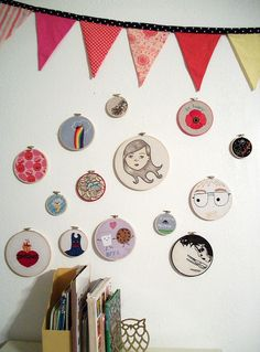Embroidery hoops . I have some of these at my house. Now I have a way to make use of them.