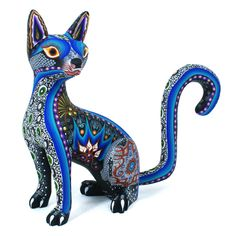 This beautiful cat is so graceful and elegant! Luis and Margarita Sosa created this delightful figure and decorated it with their classic painted designs. They are the parents of Aurora Sosa and you can see where she got her talent from! Animal Sculptures, Sculpture Art, Mexican Designs, Mexican Folk Art, Cat Art, Wood Art, Biscuit, Cat Lovers, Creatures