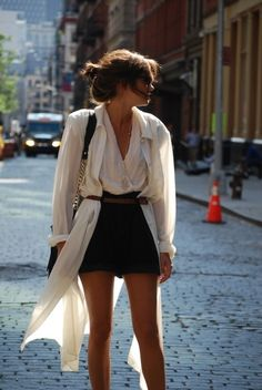 Long white cardigan belted over black shorts