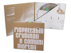 CD case Digisleeve with slanted pocket. Brown carton with white screen printing.