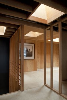 Frame House | Jonathan Tuckey Design, Holland Park, London, UK - Birch plywood flooring and douglas fir timber stud work.