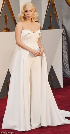 A bit of all white: Best Original Song nominee Lady Gaga looked angelic in a white pantsuit with a train