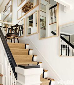 Mismatched mirrors hung to decorate the staircase