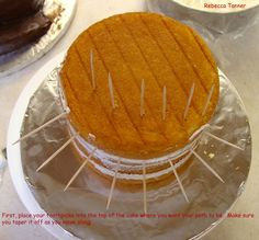 How to Carve a Spiral Cake#2: Then cut into side along toothpicks onside of cake, + you will see your pathway start to emerge 4. Find point on path where it begins to taper + measure how tall cake is at that point. Grab another 1 layer of cake, + cut a piece that is as wide as you measured + as long as you want your pathway to extend + as thick as pathway is. (you'll be standing it on its side) 5. You should now have something that looks like photo above.