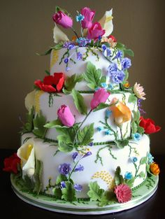 Beautiful colorful flowers wedding cake by Bobbette and Belle. #garden #flowers #wedding #cake