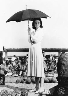 Audrey Hepburn in the Belgian Congo, photographed by Leo Fuchs during the filming of The Nun's Story. Aubrey Hepburn, Audrey Hepburn Photos, Audrey Hepburn Style, Classic Hollywood, Old Hollywood, Ladies Umbrella, Donia, Actrices Hollywood, Marlene Dietrich