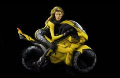 nude ladies in yoga poses body painted to look like they're riding motos.
