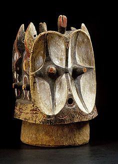 A Bembe janus helmet mask Democratic Republic of Congo, of typical form, the janus helmet mask with large concave orbits retaining original pigmentation, and raised devices to the sides. Excellent overall surface patina. Arte Tribal, Tribal Art, African Masks, African Art, African Sculptures, Statues, Art Premier, Art Sculpture, Masks Art