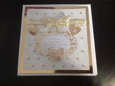 Tied together embossing folder, Sue Wilson Austrian die, Tattered lace mini bow.