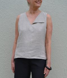 SophieTop– this loose and slightly flared top features a…