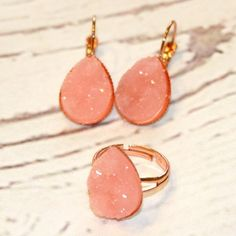 Pink Druzy Rose Gold Adjustable Ring & Earrings This is the perfect everyday ring & earrings for this spring & summer! The color is gorgeous and the ring is resizable  lead & nickel free. Faux Druzy earrings and rings are great to add some sparkle to your outfit! These beauties make an awesome gift and a great treat for yourself as well. Jewelry Rings