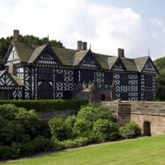 """Speke Hall, Liverpool:  Dark shadows are often seen floating around the Great Hall, and the overwhelming sense of oppression is often felt here.  The Blue Room is also reported to give an unnerving feeling, and a dark shadowy figure is seen, often whispering the words """"get out"""". In the upper corridors footsteps are often heard, endlessly walking in the dead of night when nobody is around. The sound of children crying is also a frequent occurrence, even though the hall is empty."""