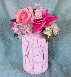 Shabby Chic Florals In Vintage Mason Jar.  Has pink crackled paint and a string of white lights.  Makes a great night light!