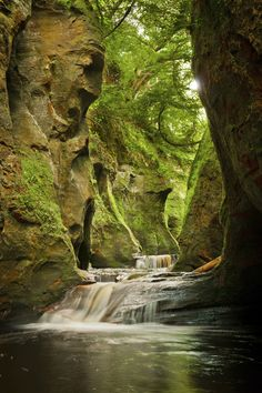 Finnich Glen, also known as The Devil's Pulpit, is a very narrow 100ft deep gorge hidden away in trees about four miles south of Drymen and about 16 miles north of Glasgow. The fast-flowing waters make it a popular spot for canyoning