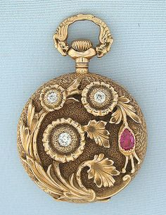 Beautiful Gruen 14K gold, diamond, and ruby beautifully decorated ladies antique pendant watch circa 1900. The case with overall engraving, the back with a high relief spray of flowers set with diamonds and a ruby. Unusual bow with mythical beasts. White enamel dial (minor hairlines) with red and gold numbers, gold and silver minute markers, and blued steel hands. Nickel 16 jewel adjusted movement.