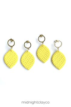 Textured yellow polymer clay earrings. Almond shaped dangle earrings with gold cut out circle shaped studs. Bright and bold earrings make the perfect accessory for a summer outfit. Give as a unique birthday gift for best friend, mother in law, or female coworker. Makes a great graduation gift! Shop these trendy handmade earrings for women in my etsy shop! Triangle Earrings, Gold Hoop Earrings, Women's Earrings, Birthday Gifts For Best Friend, Unique Birthday Gifts, How To Clean Earrings, Great Graduation Gifts, Yellow Earrings, Handmade Polymer Clay