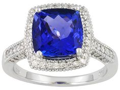 Cushion cut is so perfect for this gem. Shows all colors of red green purple and blue when u move it around