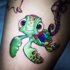 Autism awareness tattoo...Done by @jeffsaunderstattoo Squirts for Autism Awareness. Check out and give @jeffsaunderstattoo a - disneytattooart