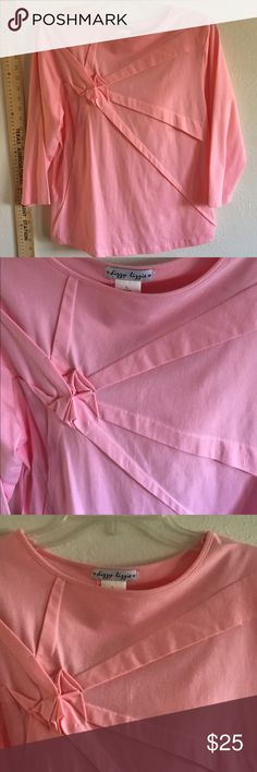 Cute pink NWT stretch top SS shirt ribbon decor! Dizzy Lizzy new with tag cute pink soft T-shirt like material top elbow length length sleeves cute ribbon design on front. Bought in boutique in tenn dizzy lizzy  Tops Tees - Short Sleeve