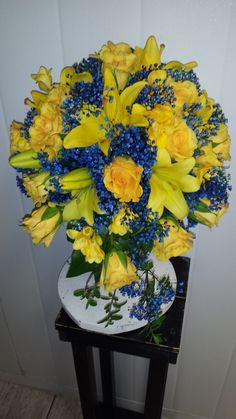 The happy color of yellow with a touch of blue sets this bouquet off