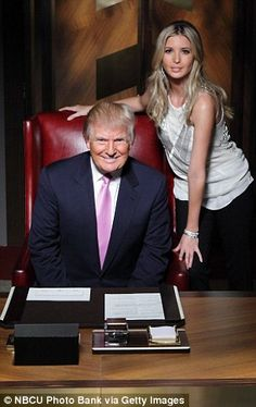 Smiling proudly with daughter Ivanka...