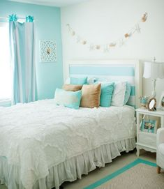 Chic, Beach-inspired Girls Bedroom Ideas - love the tiffany blue walls and white color scheme!
