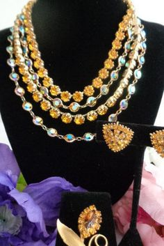 Code 50516 for 10% off Juliana AB Rhinestones 4 Strand Gold Necklace with Rhinetone Earrings & a Goldtone Amber Brooch. Priced at $70.00 before your discount. Happy Mother's Day. We have the brooch listed separately. Have a great day and make sure to go thru our section for Mother's Day. Best, Coco