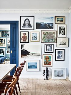 Searching for a sophisticated way to upgrade your boring dining room décor? A floor-to-ceiling gallery wall display that draws from the room's existing color palette takes a pale wall in a room from Elle Decoration Sweden from snooze-worthy to sleek in no time.