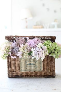 What a pretty way to display hydrangeas that are being dried - in a beautiful basket!