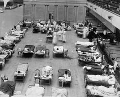 "Edward A. ""Doc"" Rogers, Volunteer nurses from the American Red Cross tending influenza sufferers in the Oakland Auditorium, Oakland, California, during the influenza pandemic of 1918. Source: Joseph R. Knowland collection at the Oakland History Room, Oakland Public Library"