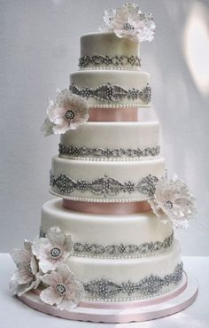 Very sophisticated wedding cake with silver detail and blush coloured ribbon detail.  ᘡղbᘡ