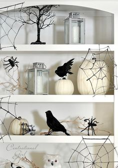 Amazing webs made from glue, black glitter & wax paper. Spookily easy to make!