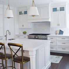 """This kitchen from the #primroseproject is checking all the boxes! Beveled subway tile ✅ gorgeous lighting ✅ Quartz countertops ✅ fabulous counter stools…"""